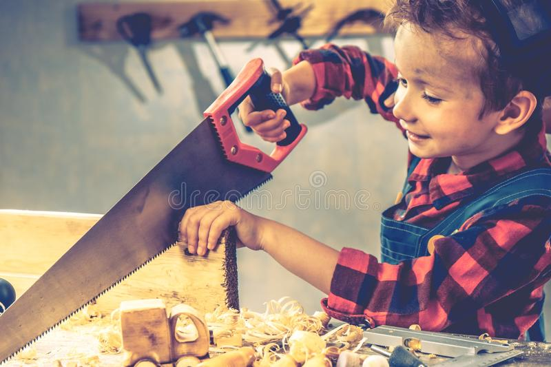 Child fathers day concept, carpenter tool,  boy home stock images