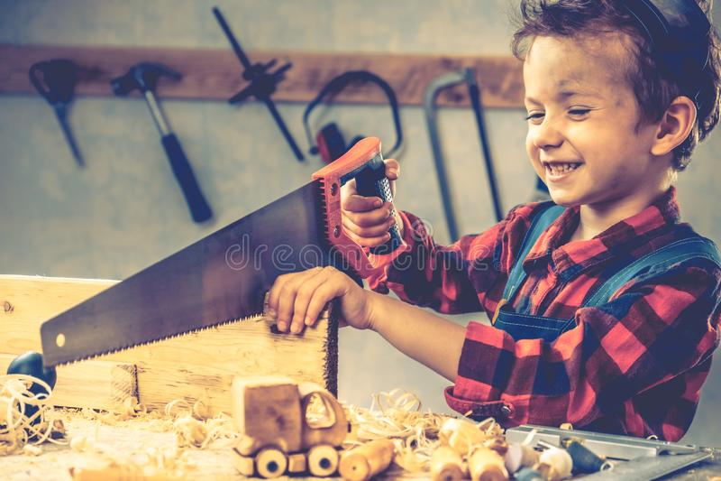 Child fathers day concept, carpenter tool,  boy workshop stock images