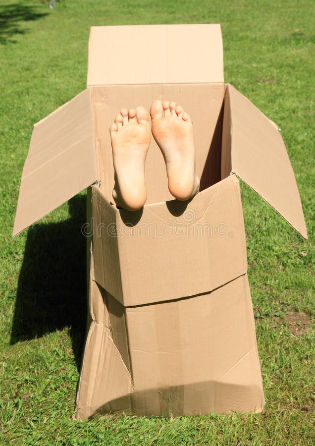 Child feet in box stock images