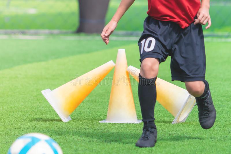 Child feet dribbling Soccer ball on a field. Child feet is dribbling Soccer ball on a field stock images