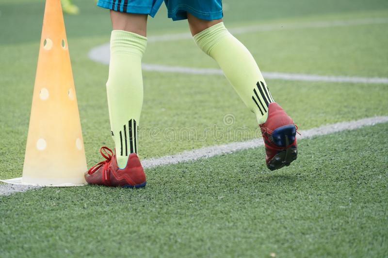 Child feet practicing running and moving on soccer field royalty free stock images