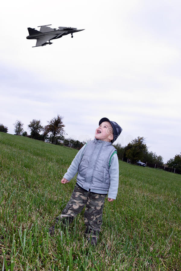 Download Child with fighter stock image. Image of speed, meadows - 24361665