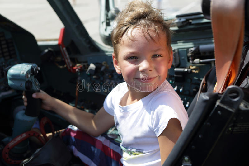 Child in fighter cockpit. Portrait of a child in fighter cockpit stock images