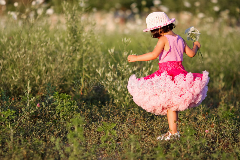 Child in a flower field royalty free stock image