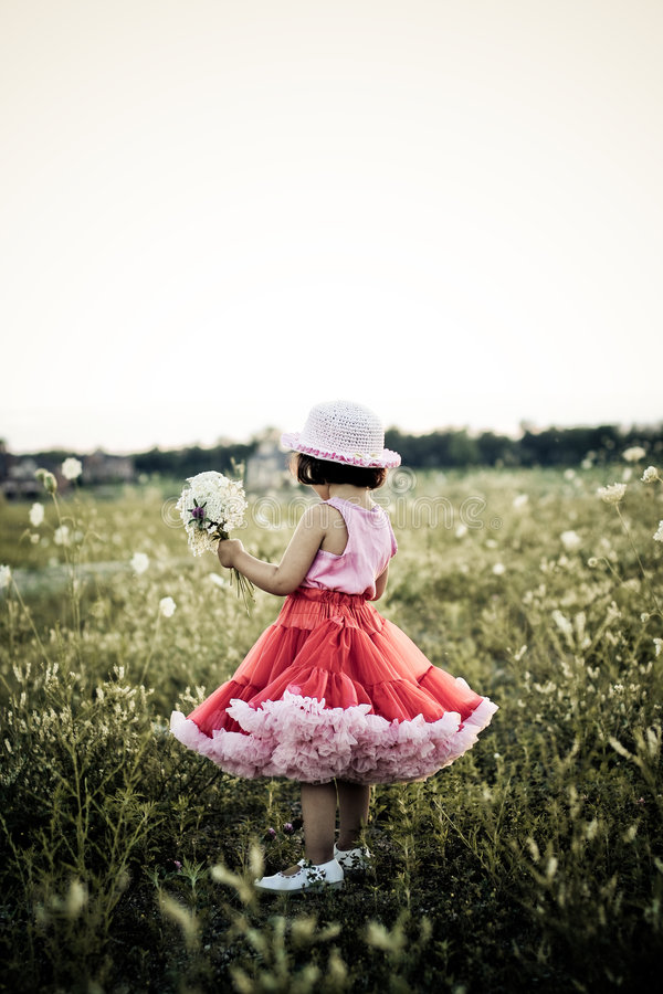 Child in a flower field royalty free stock photos