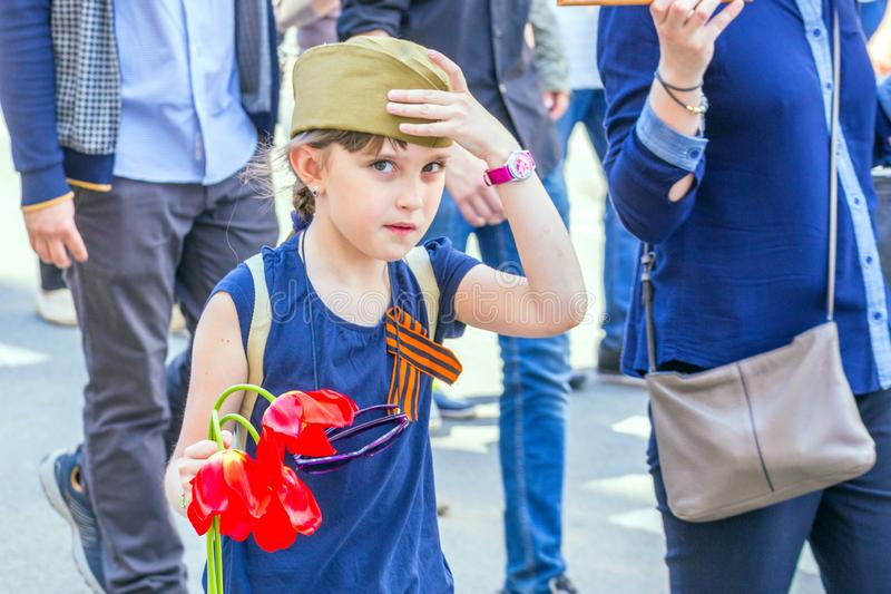 A child with flowers on the action `Immortal Regiment. Russia, Samara, May 9, 2018: A child with flowers on the action `Immortal Regiment royalty free stock image