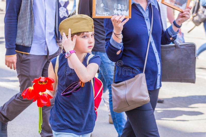 A child with flowers on the action `Immortal Regiment. Russia, Samara, May 9, 2018: A child with flowers on the action `Immortal Regiment stock photos