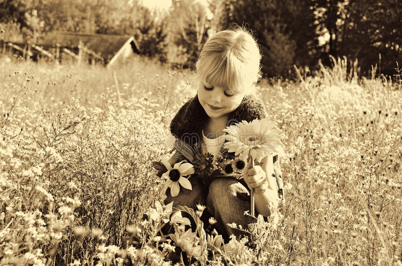 Child with flowers in sepia