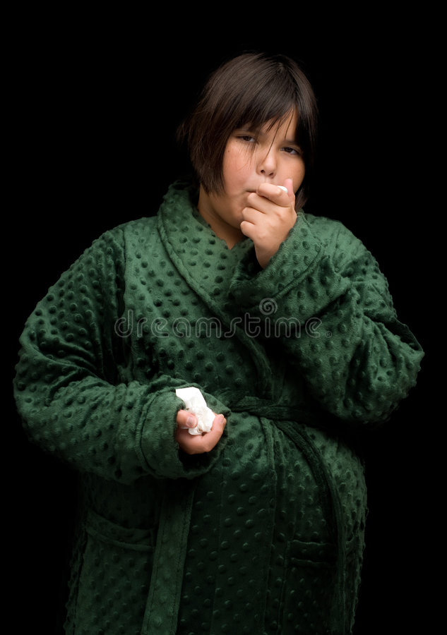 Child With The Flu. A young female child coming down with the flu stock photography