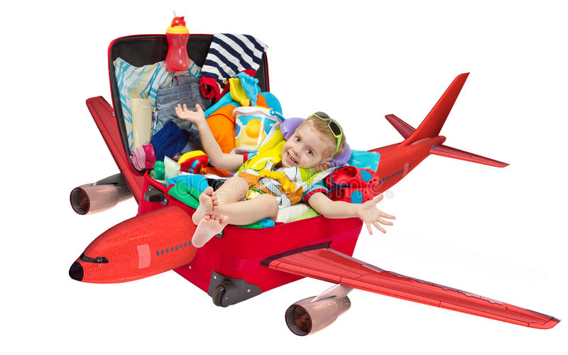 Child Flying In Travel Suitcase Packed For Vacation Stock Image