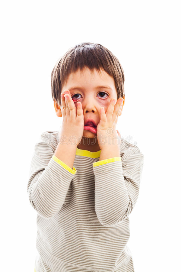 Child fooling around. Funny child making scary face, fooling around stock photos