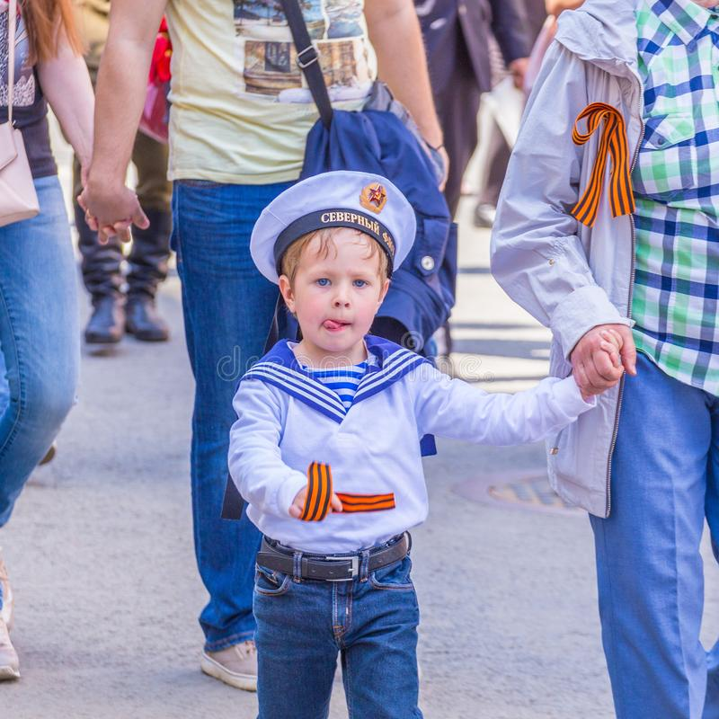 A child in the form of a sailor on the action `Immortal Regiment`. Russia, Samara, May 9, 2018: A child in the form of a sailor on the action `Immortal Regiment royalty free stock photo