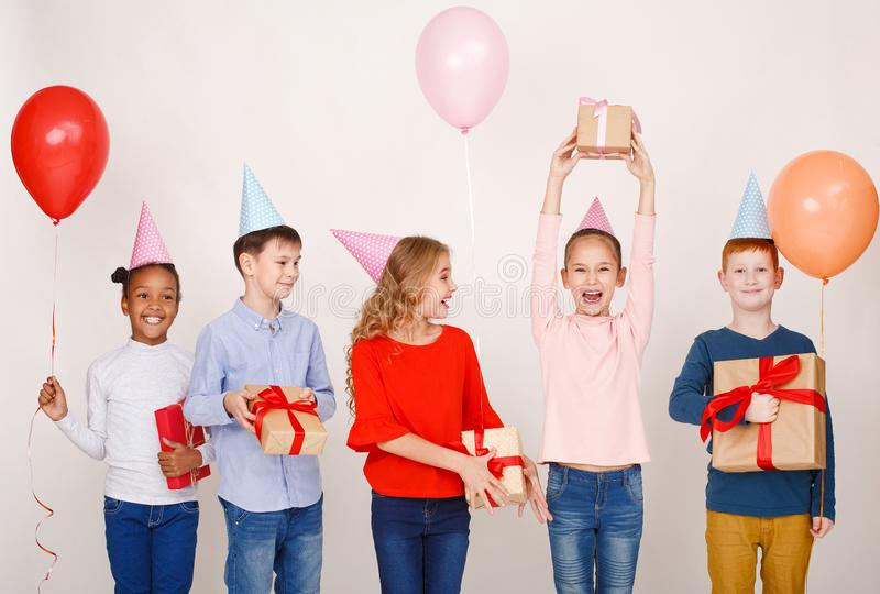 Child friends having fun at birthday party royalty free stock photo