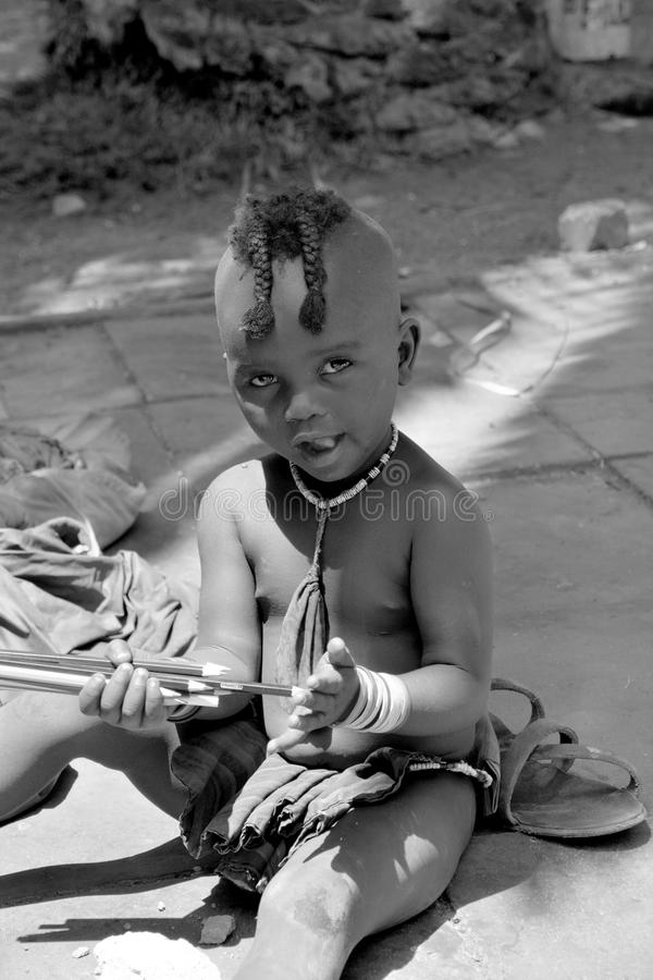 Child fron Himba tribe. SWAKOPMUND, NAMIBIA OCTOBER 09, 2014: Unidentified child fron Himba tribe living in Mondesa slum of Swakopmund on october 09 2014. In stock image