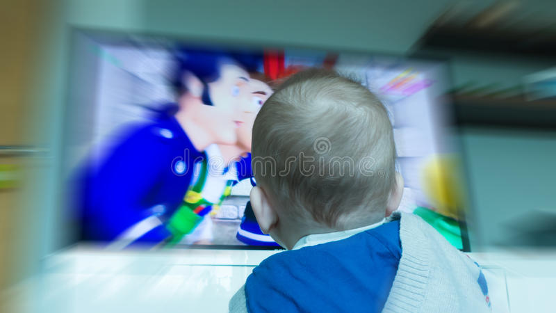 Child in front of TV screen royalty free stock photo