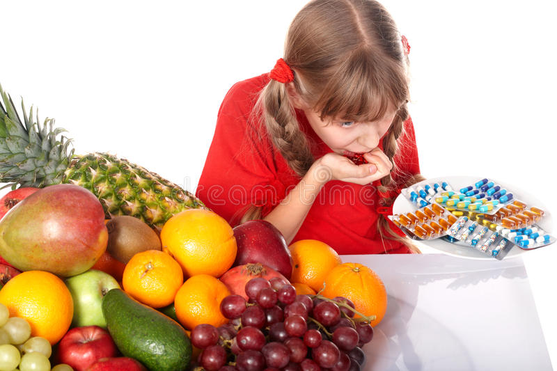 Download Child With Fruit And Vitamin Pill. Stock Image - Image: 21634375