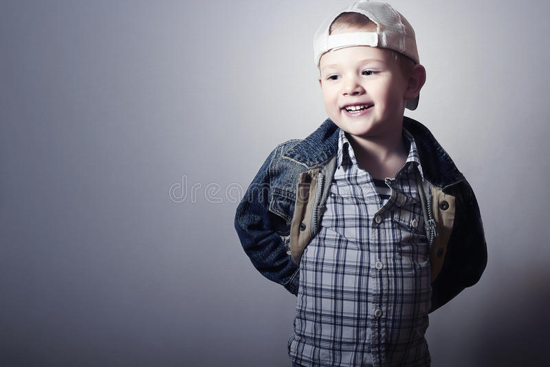 Child. Funny Little Boy in Jeans. Trucker cap. joy. Fashionable Kid. plaid shirt. Denim Wear stock photos