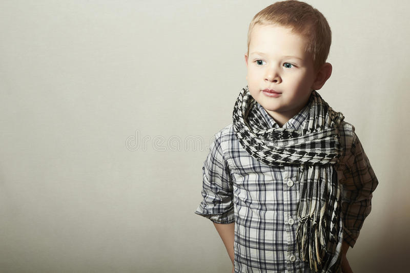 Child. funny little boy in scurf. Fashion Children. 4 years old. plaid shirt royalty free stock images