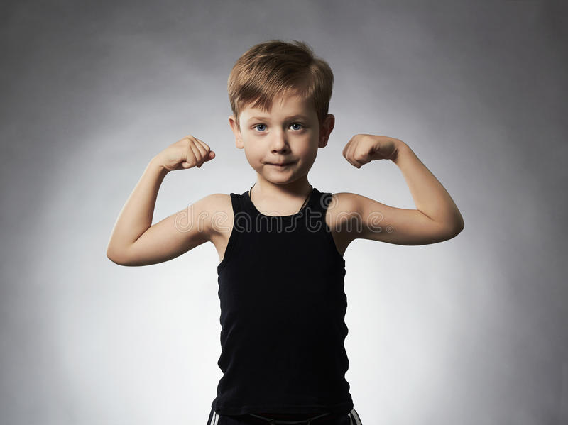 Child. Funny Little Boy.Sport Handsome Boy showing his hand biceps muscles. Child. Funny Little Boy.Sport Handsome Boy.bodybuilder showing his hand biceps stock photo