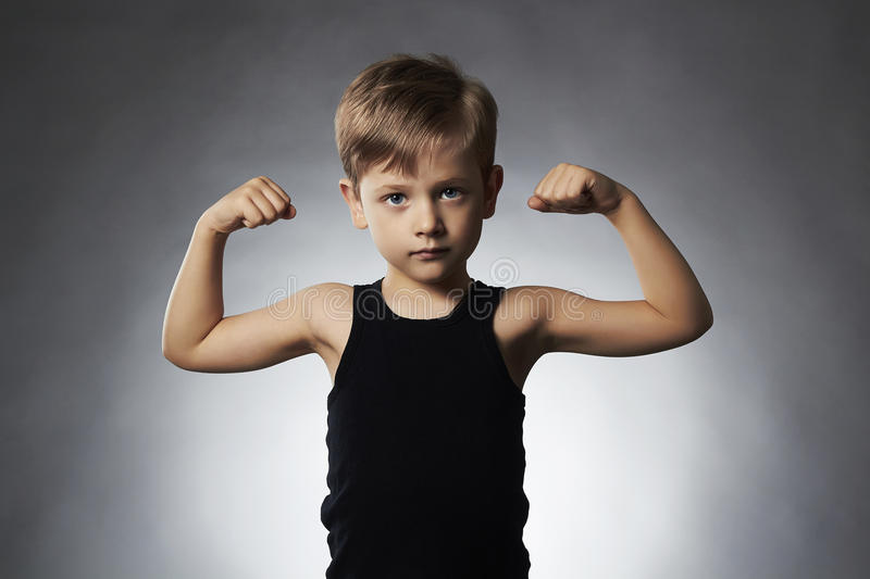 Child. Funny Little Boy.Sport Handsome Boy showing his hand biceps muscles. Child. Funny Little Boy.Sport Handsome Boy.bodybuilder showing his hand biceps royalty free stock photo