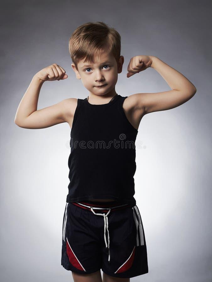 Child. Funny Little Boy.Sport Handsome Boy showing his hand biceps muscles. Child. Funny Little Boy.Sport Handsome Boy.bodybuilder showing his hand biceps stock photo