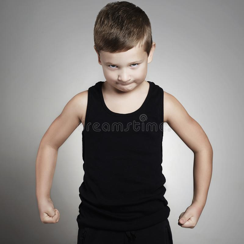 Child.Funny sport Little Boy.strong kid. Child.Funny sport Little Boy showing his muscles.strong kid stock photography
