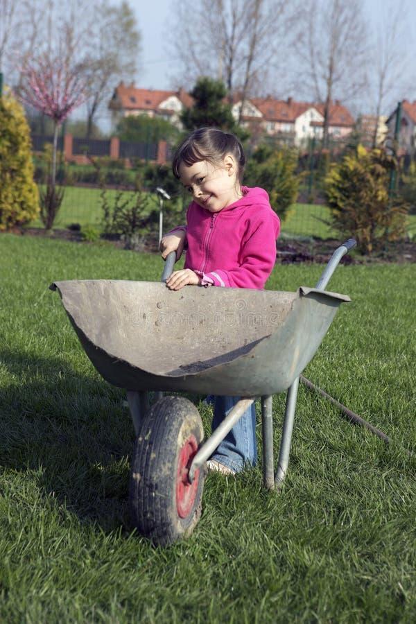 Child in the garden. Child is working in the garden stock photo