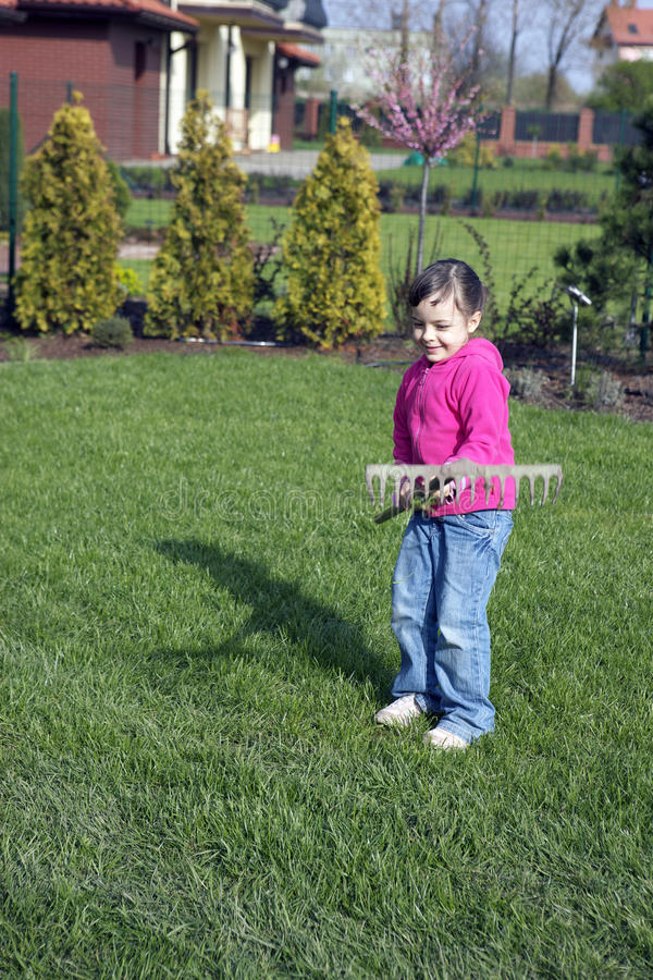 Child in the garden. Child is working in the garden royalty free stock images