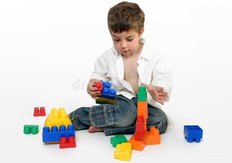 Child with generic building blocks stock image