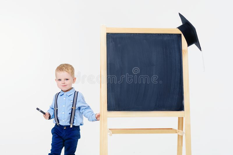 The child is getting ready for school royalty free stock images