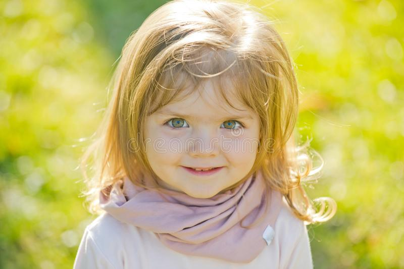 Child with adorable face, long hair smile on sunny day royalty free stock photo
