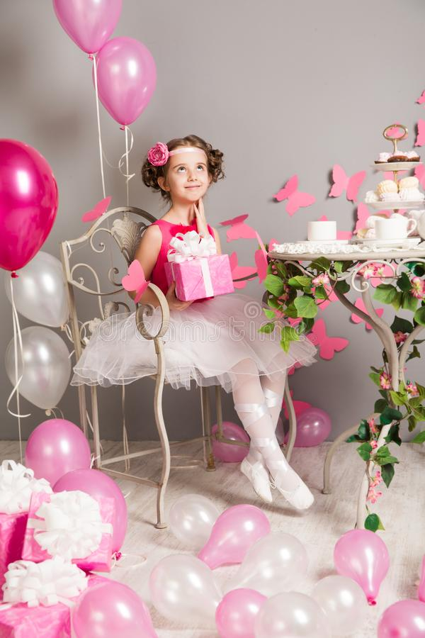 Child Girl Birthday Party, Dreaming Kid with Present Gift Box stock photo