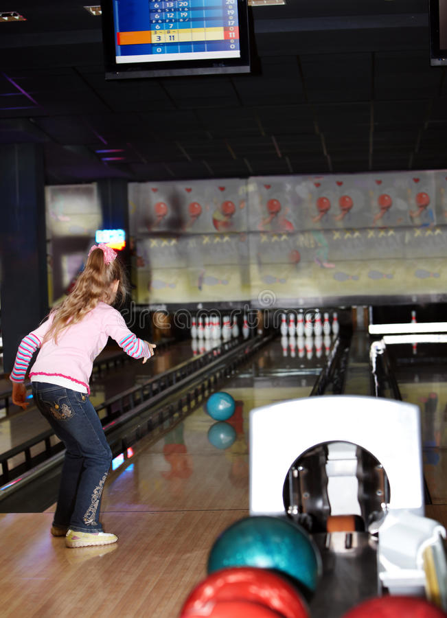Child girl in with bowling ball. stock photo