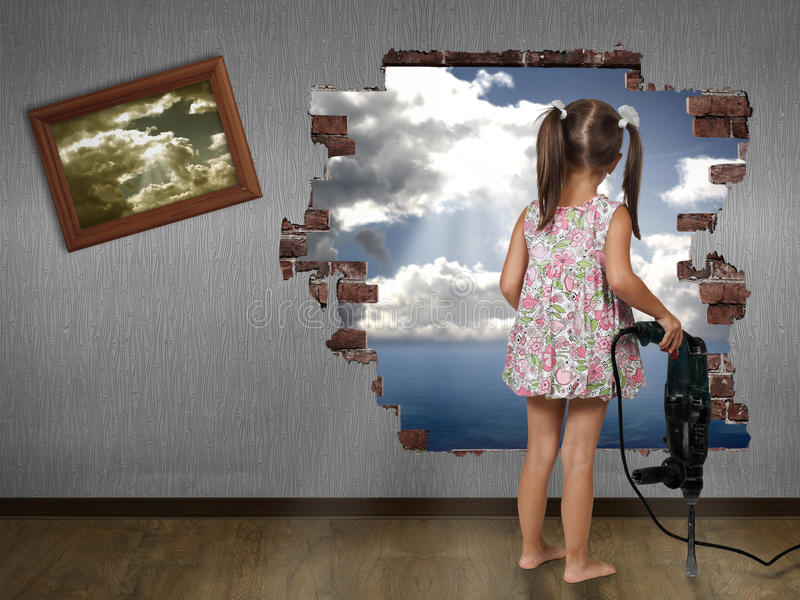 Child girl break the wall. Discovery concept royalty free stock photography