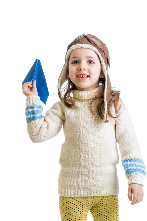 Child girl dressed as pilot playing with paper airplane isol stock photos