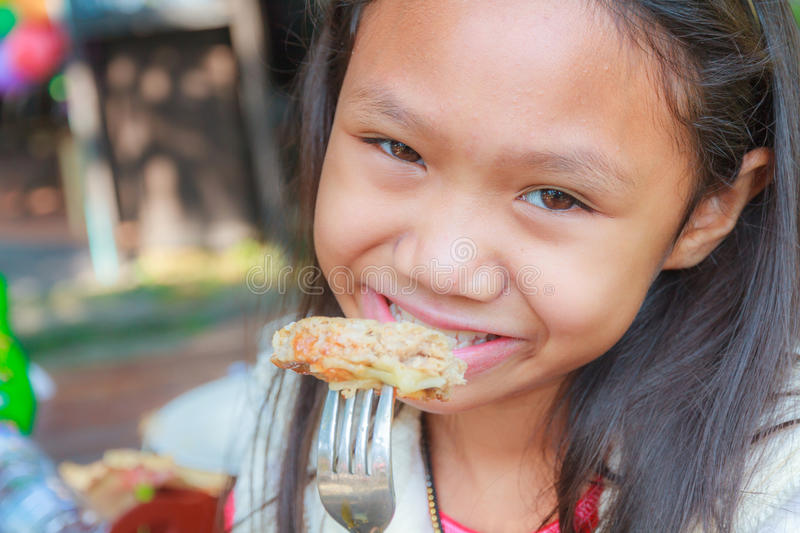 Child girl eat hamburger pork stock photo