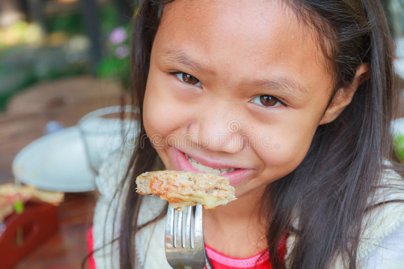 Child girl eat hamburger pork stock photos