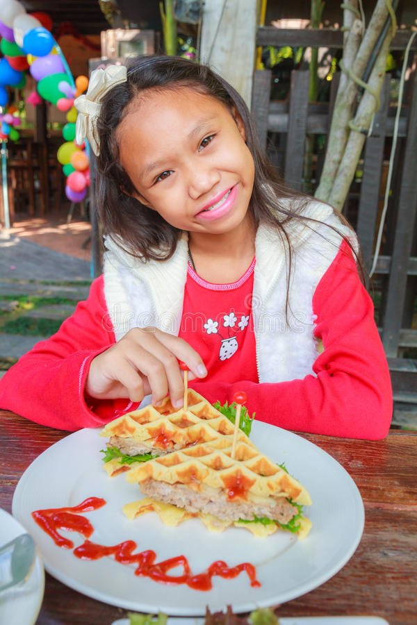 Child girl eat waffles pork stock photography
