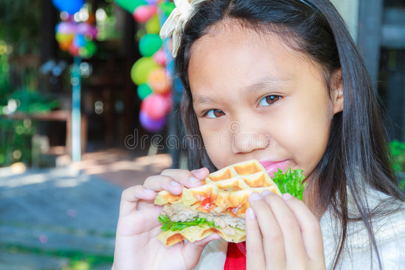 Child girl eat waffles pork stock photo