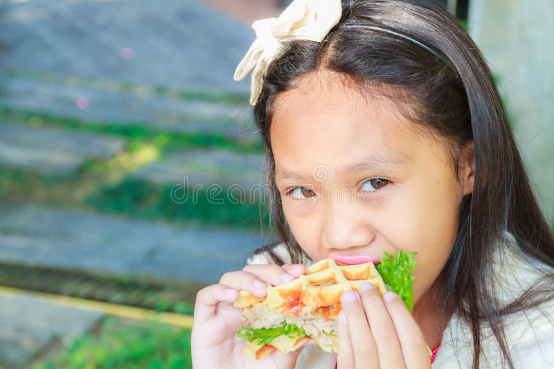Child girl eat waffles pork stock images