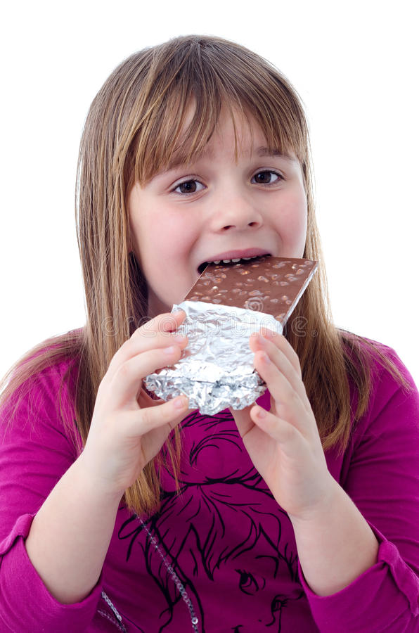 Child Girl Eating Chocolate Royalty Free Stock Photos