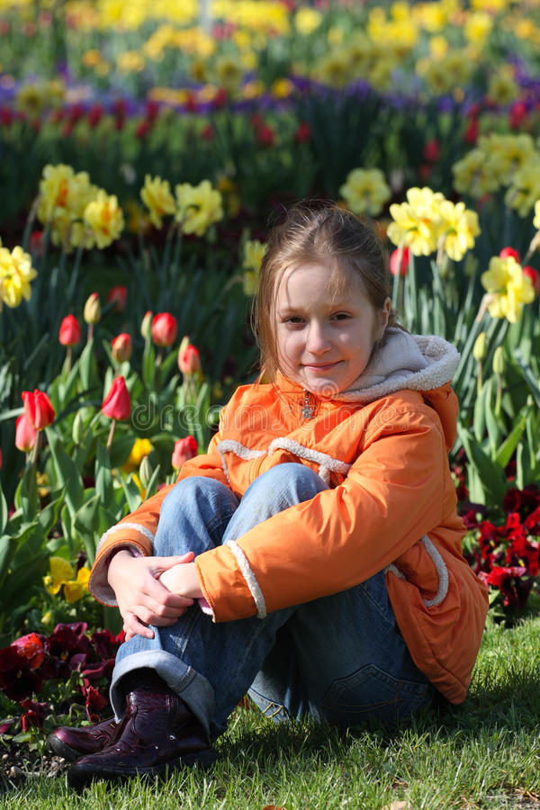 Download Child girl on a grass stock photo. Image of flowers, park - 19544336