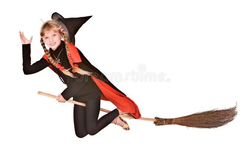 Child girl Halloween witch in black fly on broom. Child girl in costume Halloween witch in black dress and hat fly on broom.Isolated royalty free stock images