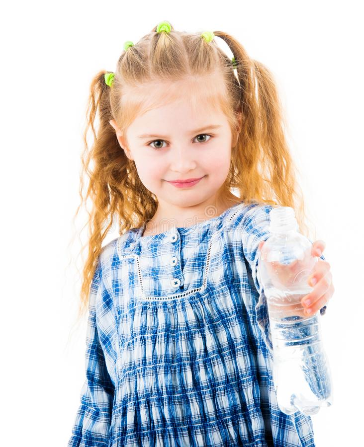 Child girl holding open bottle of water. Little child girl holding open bottle of mineral water isolated on white background royalty free stock image