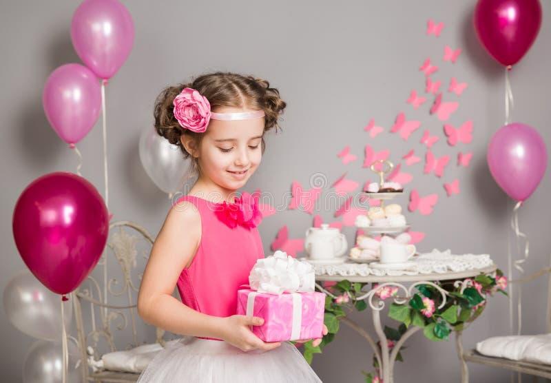 Child Girl holding Present Gift Box, Happy Kid Retro Style royalty free stock photos