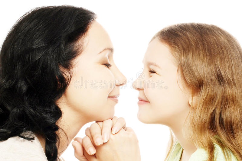 Child girl with mother playing stock images