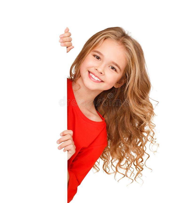 Child girl peeking out from empty banner. Isolated on white background royalty free stock image
