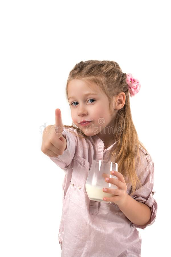 The child girl with pleasure drinks milk. The girl with pleasure drinks milk stock photos