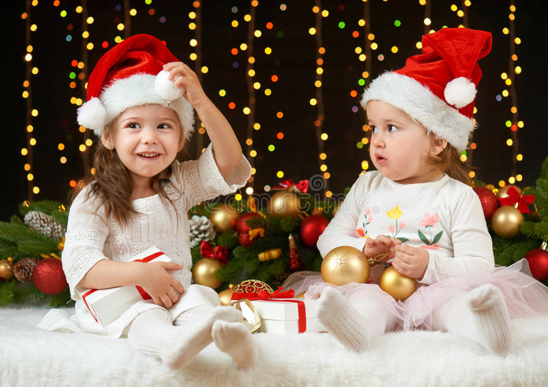Child girl portrait in christmas decoration, happy emotions, winter holiday concept, dark background with illumination and boke li stock photography