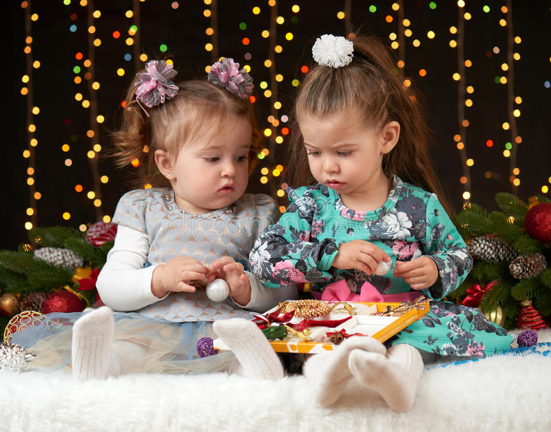 Child girl portrait in christmas decoration, happy emotions, winter holiday concept, dark background with illumination and boke li royalty free stock images